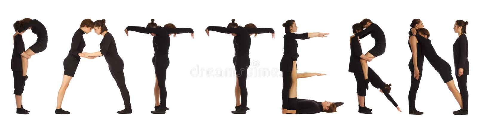 Black dressed people forming PATTERN word stock images