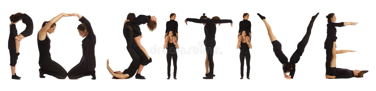 Black dressed people forming POSITIVE word. Over white background stock photo