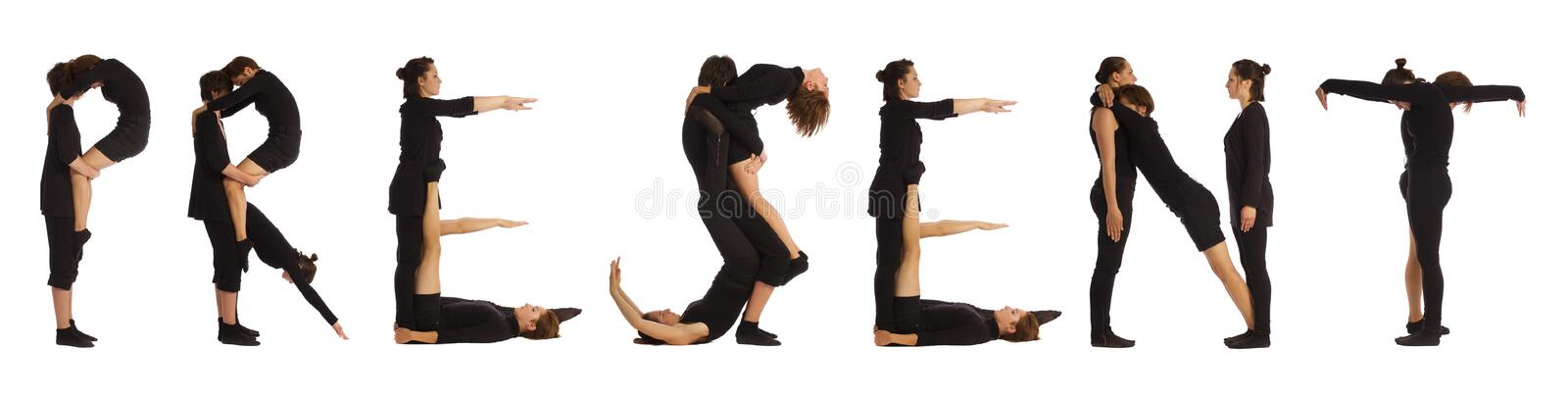 Black dressed people forming PRESENT word. Over white background royalty free stock photo