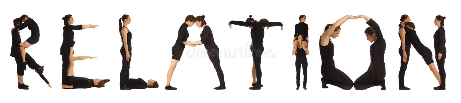Black dressed people forming RELATION word. Over white background stock photos