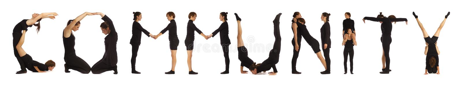Black dressed people forming word COMMUNITY. On white background stock photo