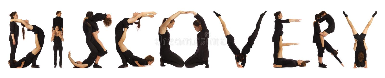 Black dressed people forming word DISCOVERY stock photo