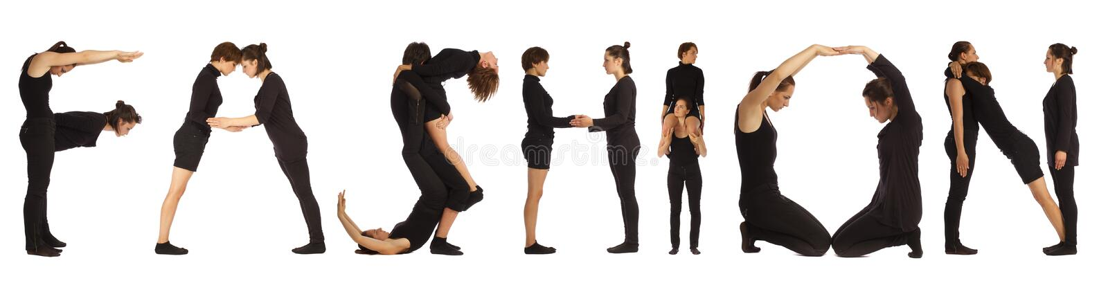 Black dressed people forming word FASHION royalty free stock photography