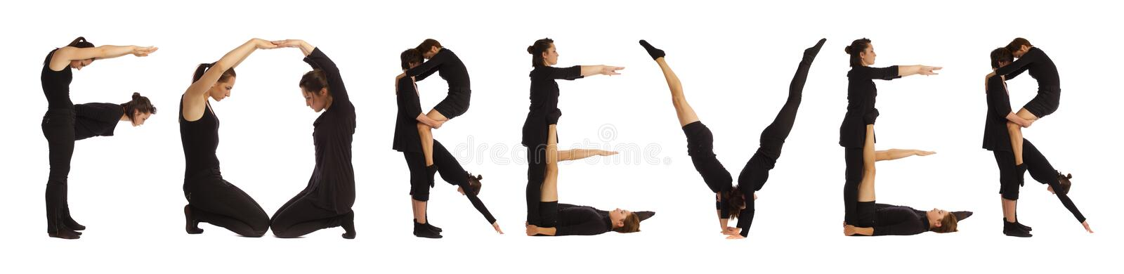 Black dressed people forming word FOREVER stock photography