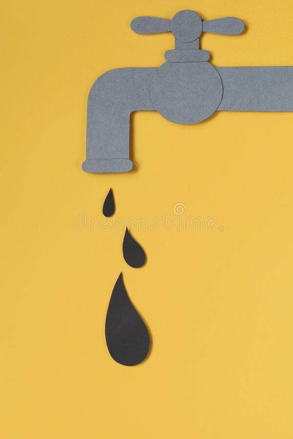 Black drop dripping from tap. Oil concept. stock image