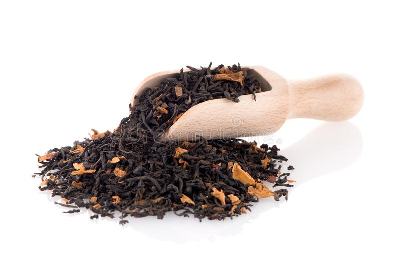 Black Dry Tea with a Wooden Spoon royalty free stock photography