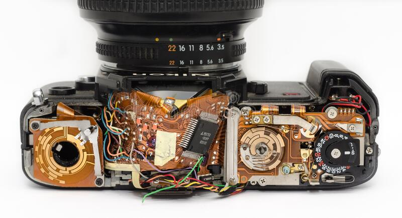 Black Dslr Camera Showing Its Circuit Board Free Public Domain Cc0 Image