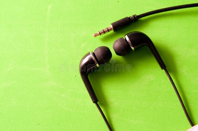 Black earphones and jack for connection isolated stock image