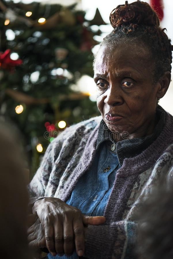 A black elderly woman in Chrismas holiday stock photo