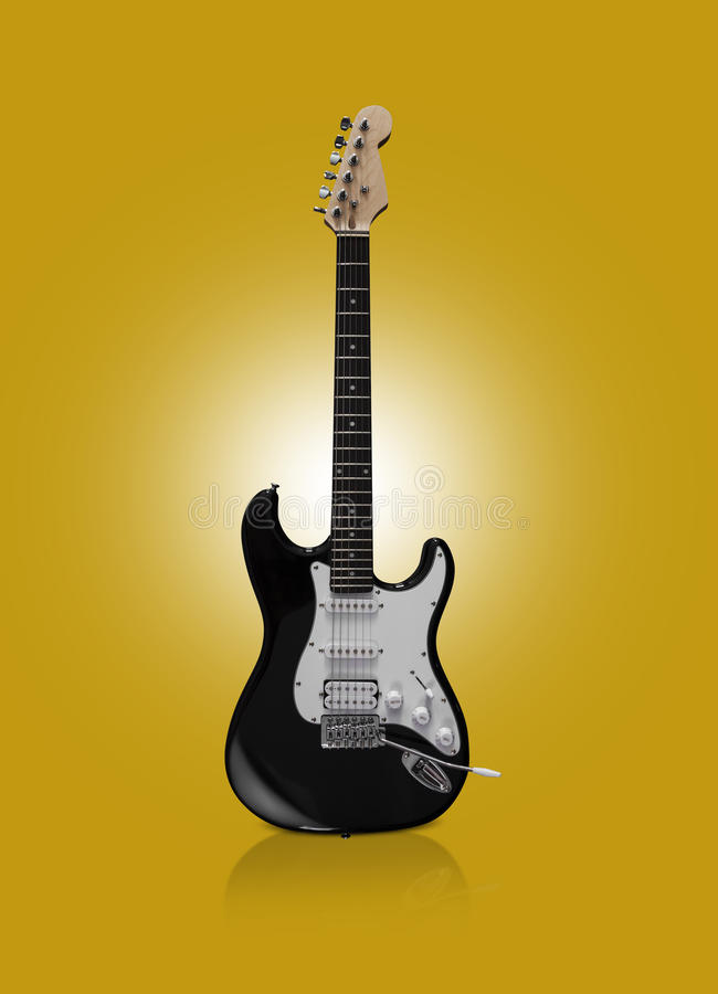 Black electric guitar on yellow background stock images