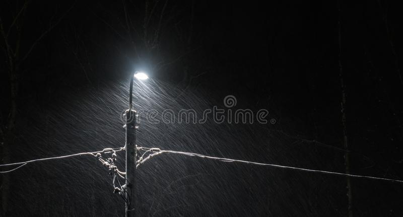 Black Electric Lamp Post With Lighted Lamp during Nighttime royalty free stock photo