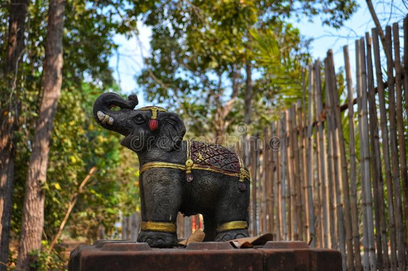 Black elephant statue in Thai countryside royalty free stock images