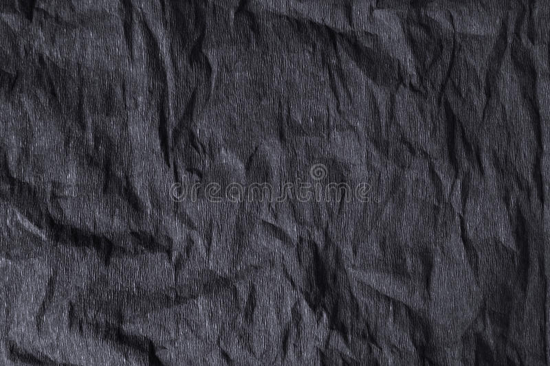 Black embossed background. Structure carbon black color graphite stock photo