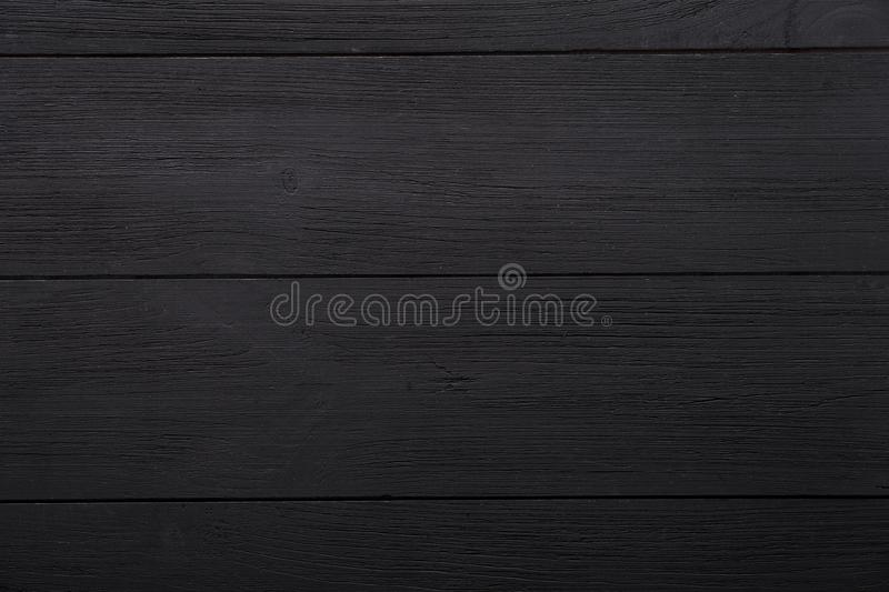 Black empty blank wooden background, painted dark table desk surface, wood texture boards with copy space, top view stock image