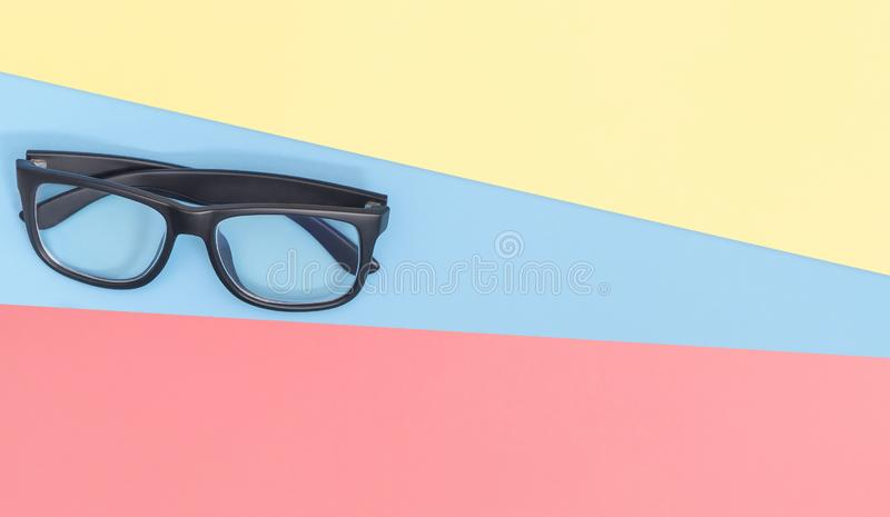 Eye Glass on blue pink yellow copy space stock photography