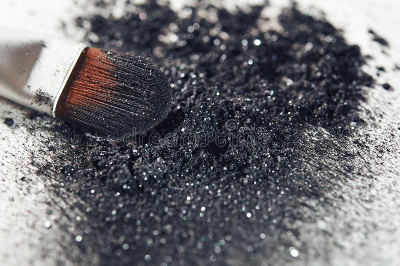 Black eye shadow. And brush close up royalty free stock images
