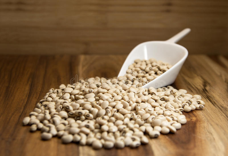 Black eyed peas. Beans on wooden background. Selective focus stock photos