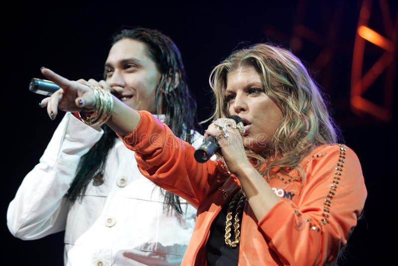 Black Eyed Peas exécutent de concert photos libres de droits