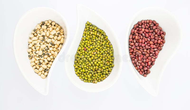 Black Eyed Peas, Mung, Azuki Bean II. Black eyed peas, mung bean, azuki bean in ceramic bowls royalty free stock photography