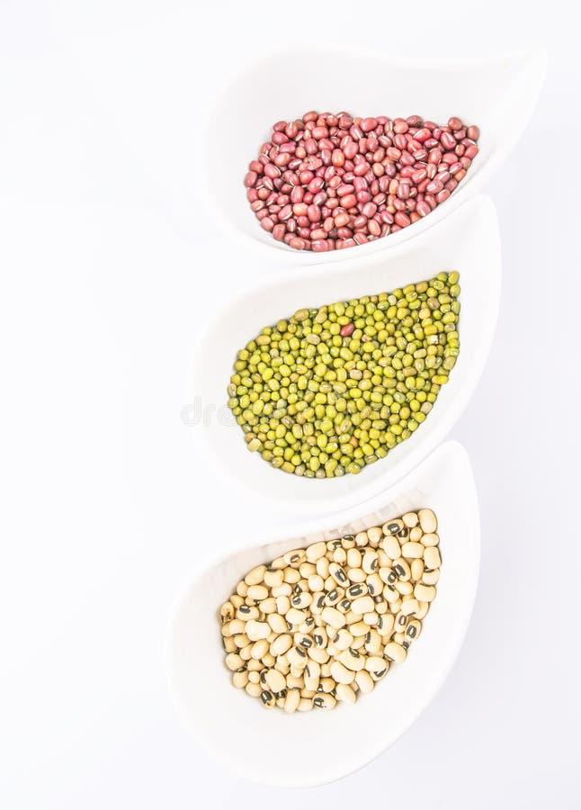 Black Eyed Peas, Mung, Azuki Bean IV. Black eyed peas, mung bean, azuki bean in ceramic bowls stock photo