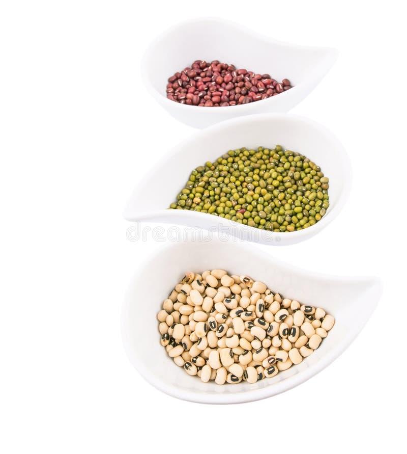Black Eyed Peas, Mung, Azuki Bean V. Black eyed peas, mung bean, azuki bean in ceramic bowls stock image