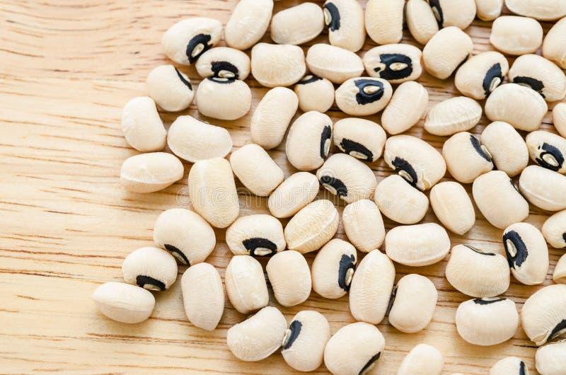 Black eyed peas. Black eyed peas seeds on wooden background royalty free stock photos