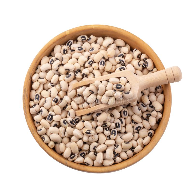 Black-eyed peas in a wooden bowl isolated on a white background. Agriculture bean cooking diet dry eat food fresh health healthy ingredient natural nutrition stock photography
