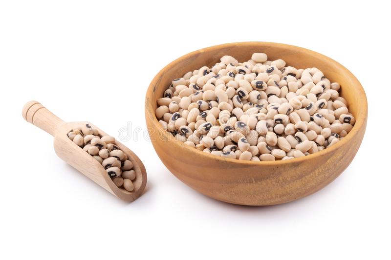 Black-eyed peas in a wooden bowl isolated on a white background. Agriculture bean cooking diet dry eat food fresh health healthy ingredient natural nutrition royalty free stock images