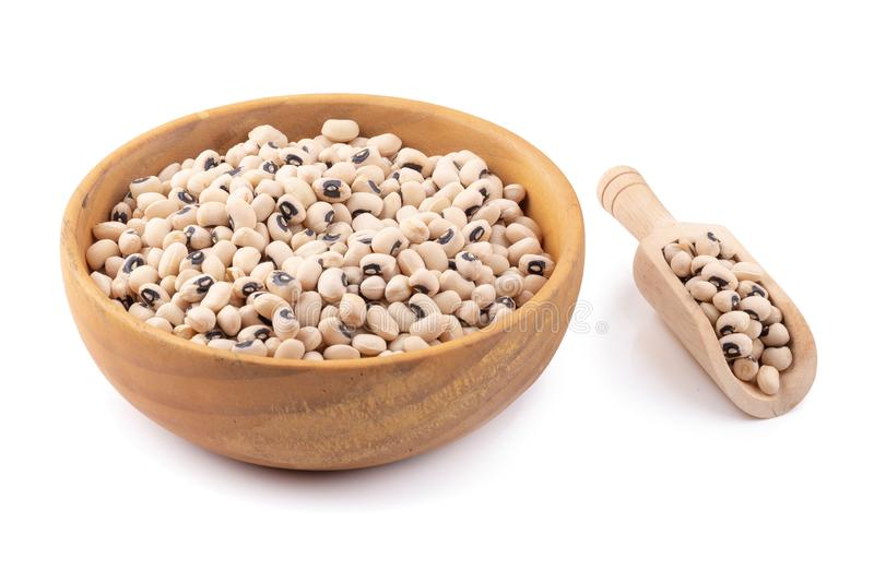 Black-eyed peas in a wooden bowl isolated on a white background. Agriculture bean cooking diet dry eat food fresh health healthy ingredient natural nutrition royalty free stock image