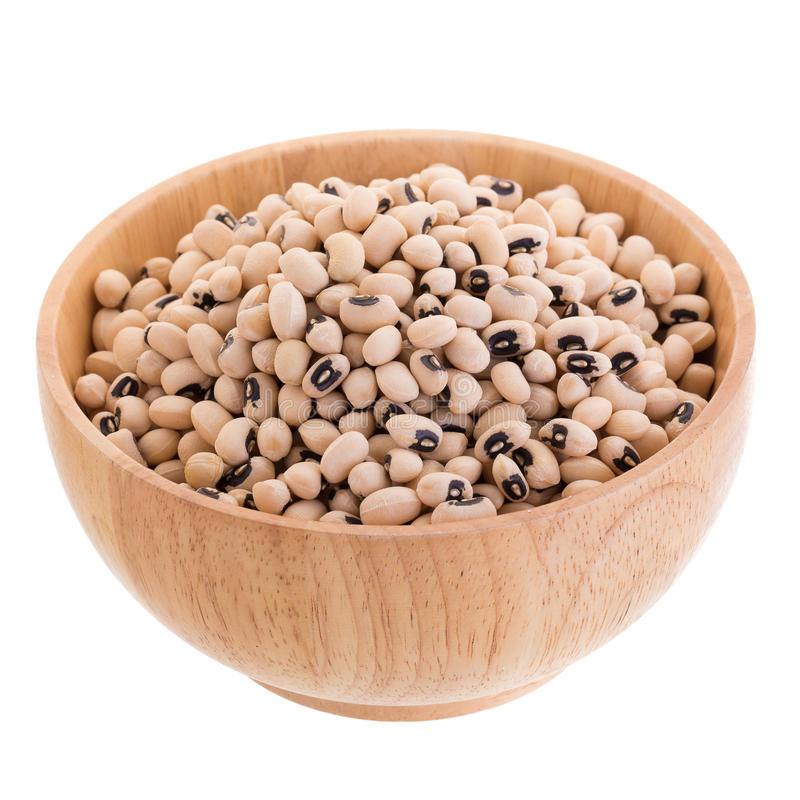 Black-eyed peas in a wooden bowl isolated on a white background.  stock image