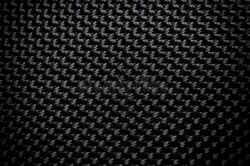 Black fabric canvas silk texture background. Abstract closeup detail of textile material wallpaper. Cloth, shadow, dark, mesh, woven, burlap, cotton, classic stock photos