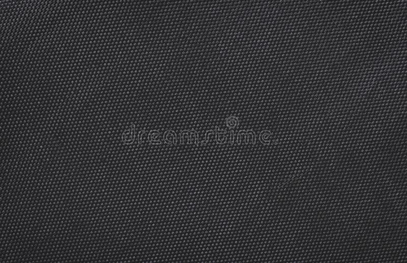 Black fabric canvas silk texture background. Abstract closeup detail of textile material wallpaper. Cloth, shadow, dark, mesh, woven, burlap, cotton, classic stock photography