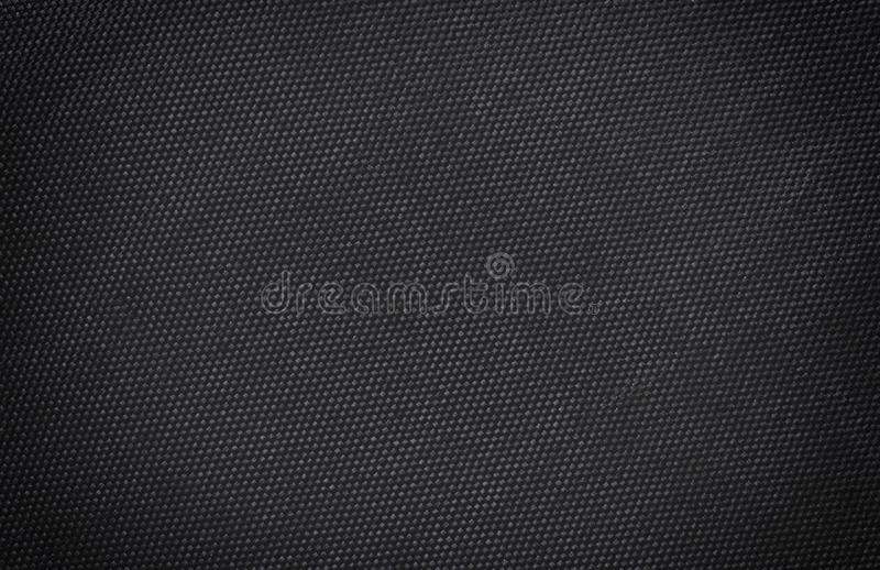 Black fabric canvas silk texture background. Abstract closeup detail of textile material wallpaper. Cloth, shadow, dark, mesh, woven, burlap, cotton, classic royalty free stock image