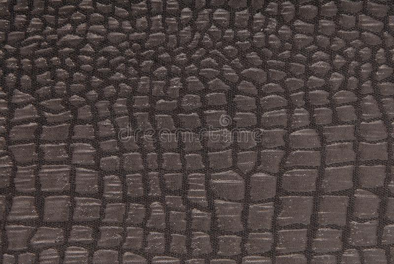 Black fabric with crocodile pattern royalty free stock photo