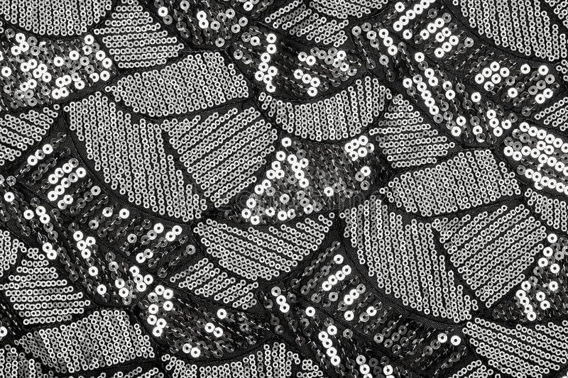 Black fabric with shiny silver sequin design royalty free stock photography