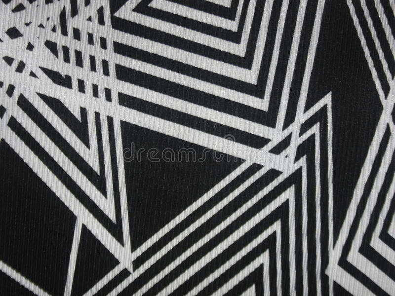 Black fabric texture with angular white lines. Black fabric texture background with angular white stripes royalty free stock image