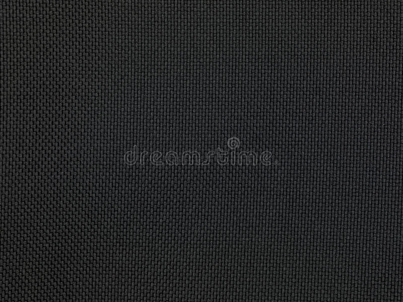 Black fabric texture background. Close up stock photography