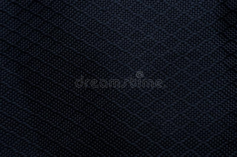 Black fabric texture background. Detail of canvas textile material. stock photos
