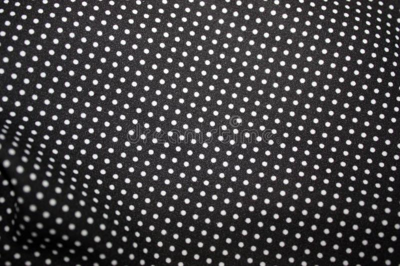 Black fabric and white tiny polka dot background, close-up. Black Fabric and White Tiny Polka Dots Background, fashion, design, abstract, retro, pattern, vintage royalty free stock photos