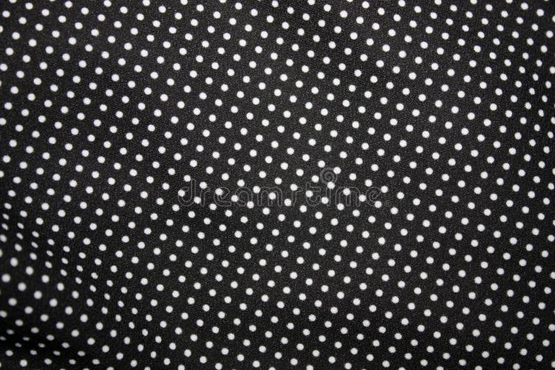 Black fabric and white tiny polka dot background, close-up. Black Fabric and White Tiny Polka Dots Background, fashion, design, abstract, retro, pattern, vintage stock photography