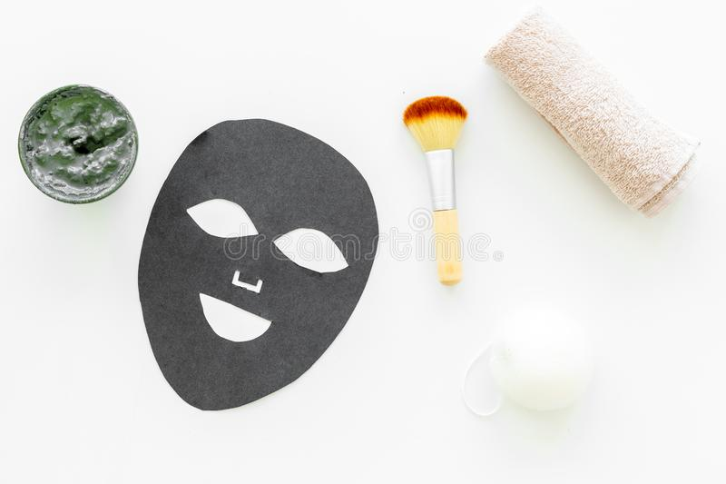 Black facial mask. Black head remover mask. Mask with clay on white background top view.  stock photography