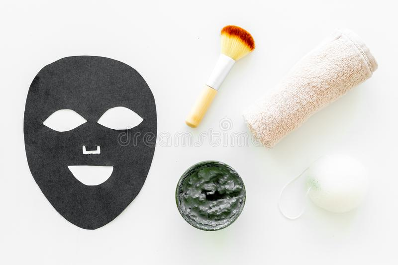 Black facial mask. Black head remover mask. Mask with clay on white background top view.  stock images