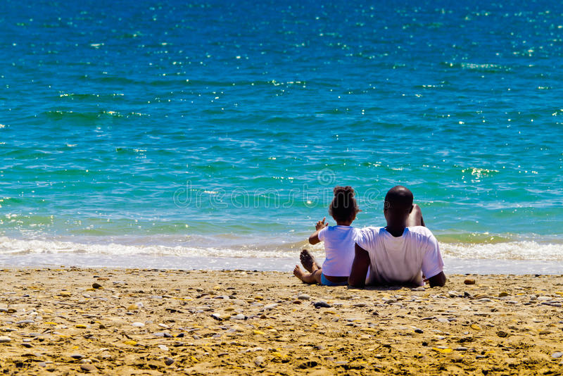 Download Black family and azure sea stock photo. Image of childhood - 23058976
