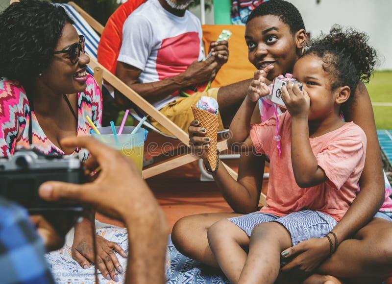 Black family enjoying summer together at backyard royalty free stock image