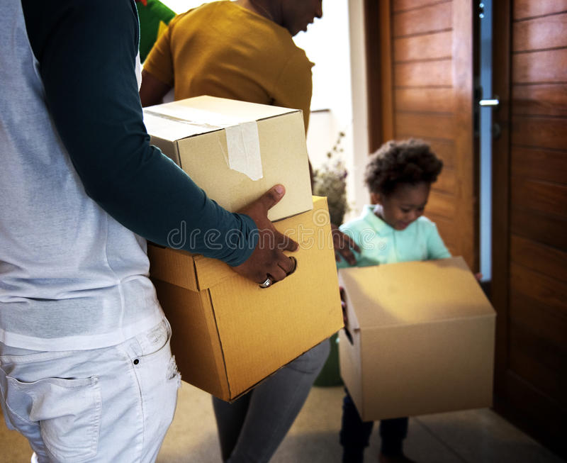 Black family moving in to their new house royalty free stock image