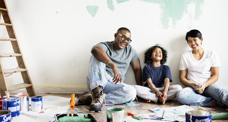 Black family painting house wall royalty free stock image