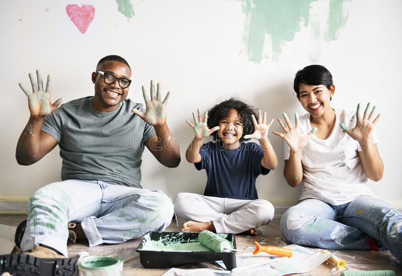 Black family painting house wall royalty free stock photography