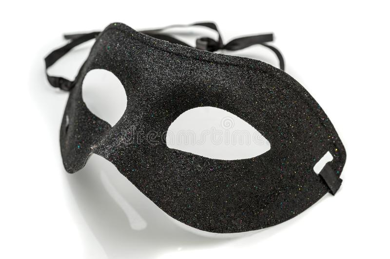 Black Fancy party mask on white background stock image
