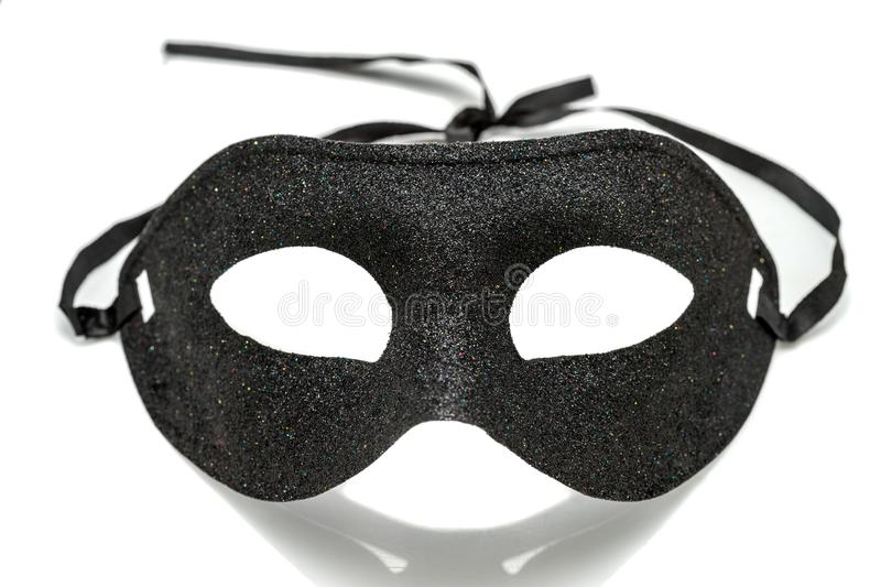 Black Fancy party mask on white background stock images