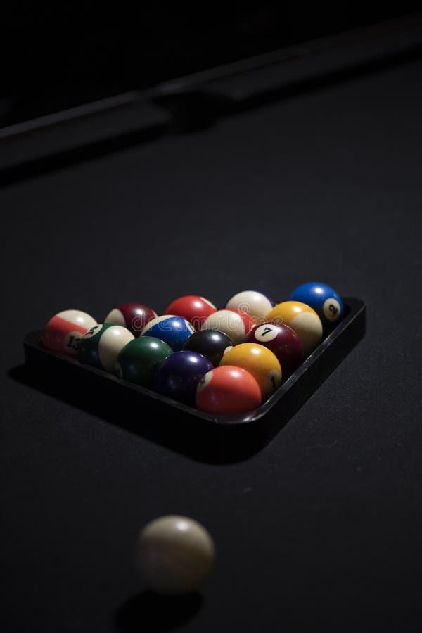 Black felt and racked balls stock photography